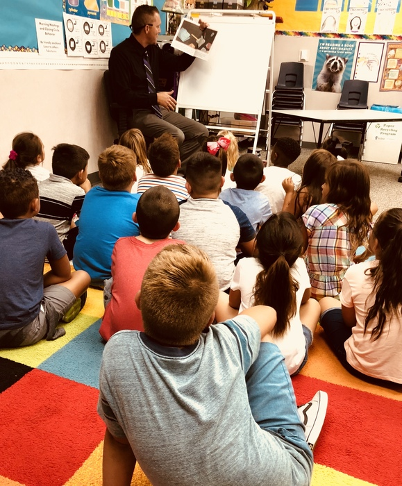 Principal Mr. Sheffield does an impromptu reading of There Was an Old Lady Who Swallowed a Book for Mrs. McCann's 2nd Grade Class.