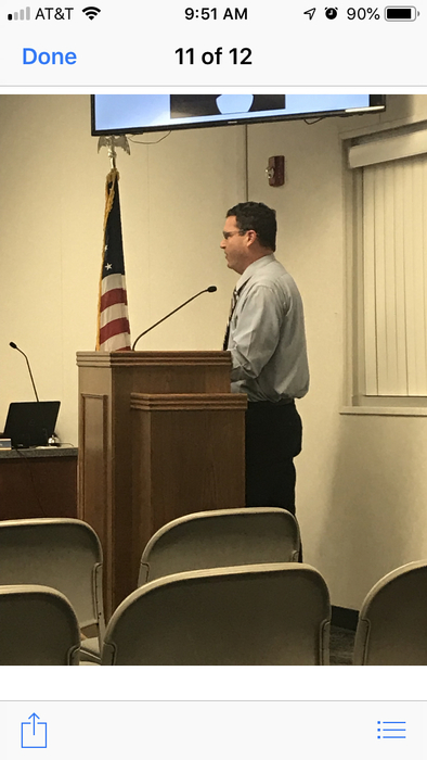 Mr. Gunter speaks to the school board to share parent concerns about covering our cafeteria.