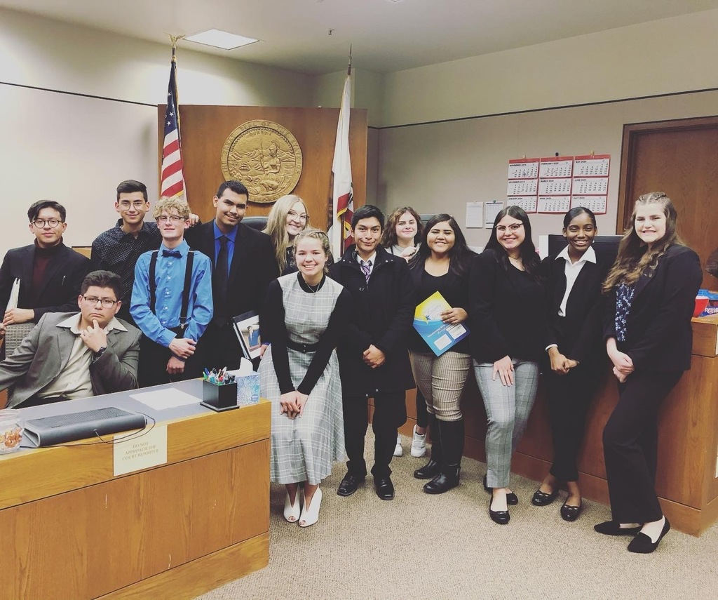Mock Trial team in front of the bench.