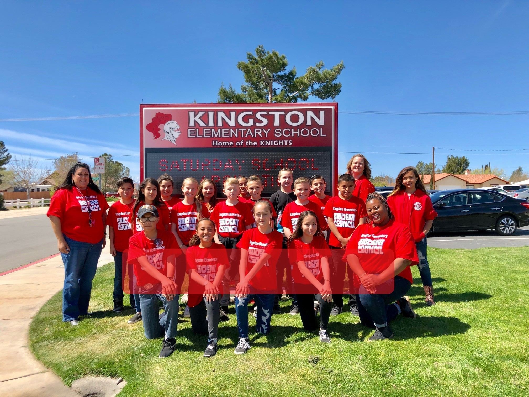 Kingston Student Council posing in front of sign
