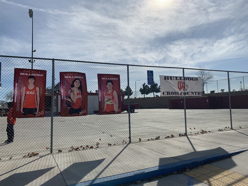 Cross Country Student Picture banners on fence